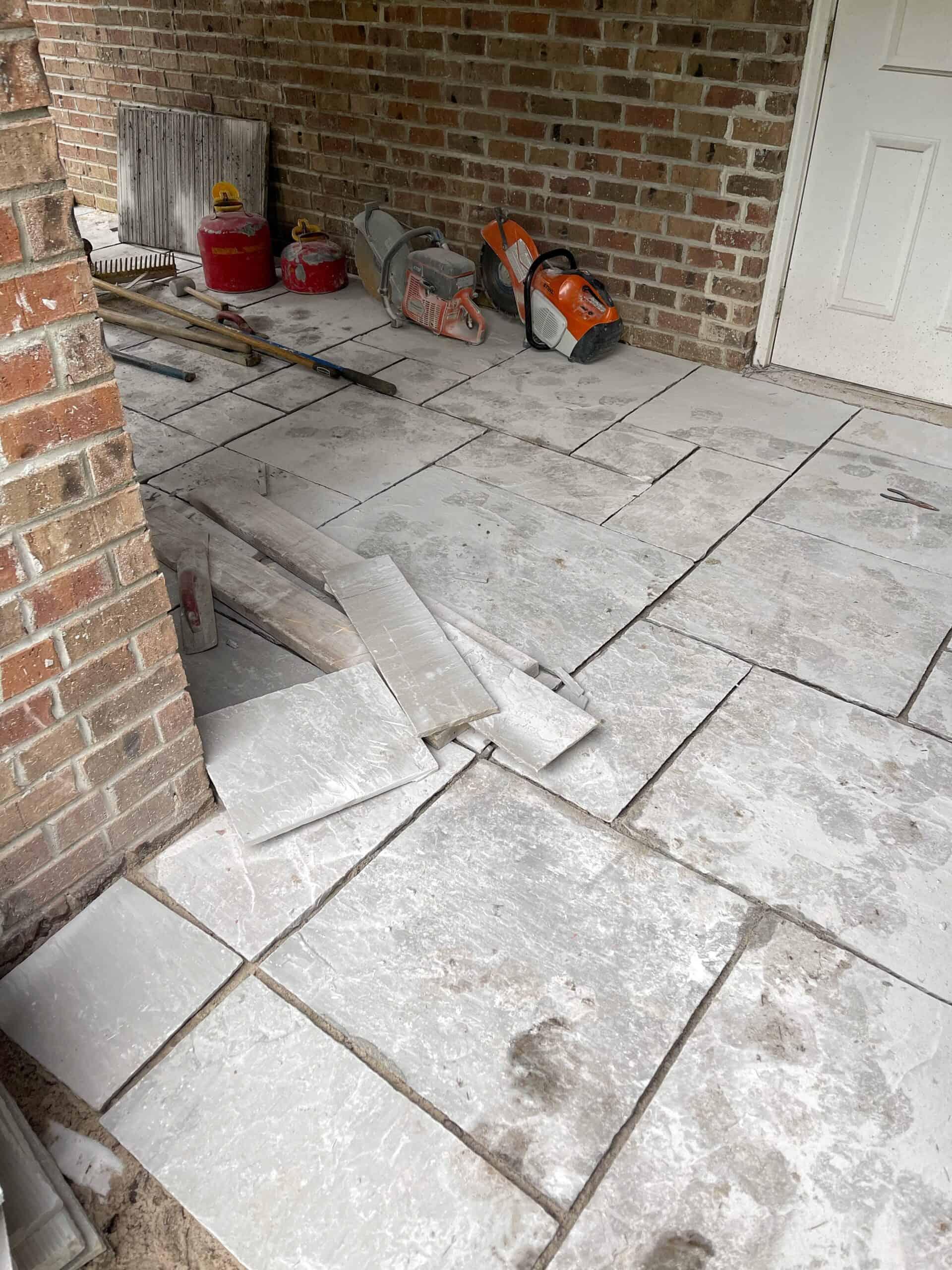 Flagstone cut in pieces around brick pillars.