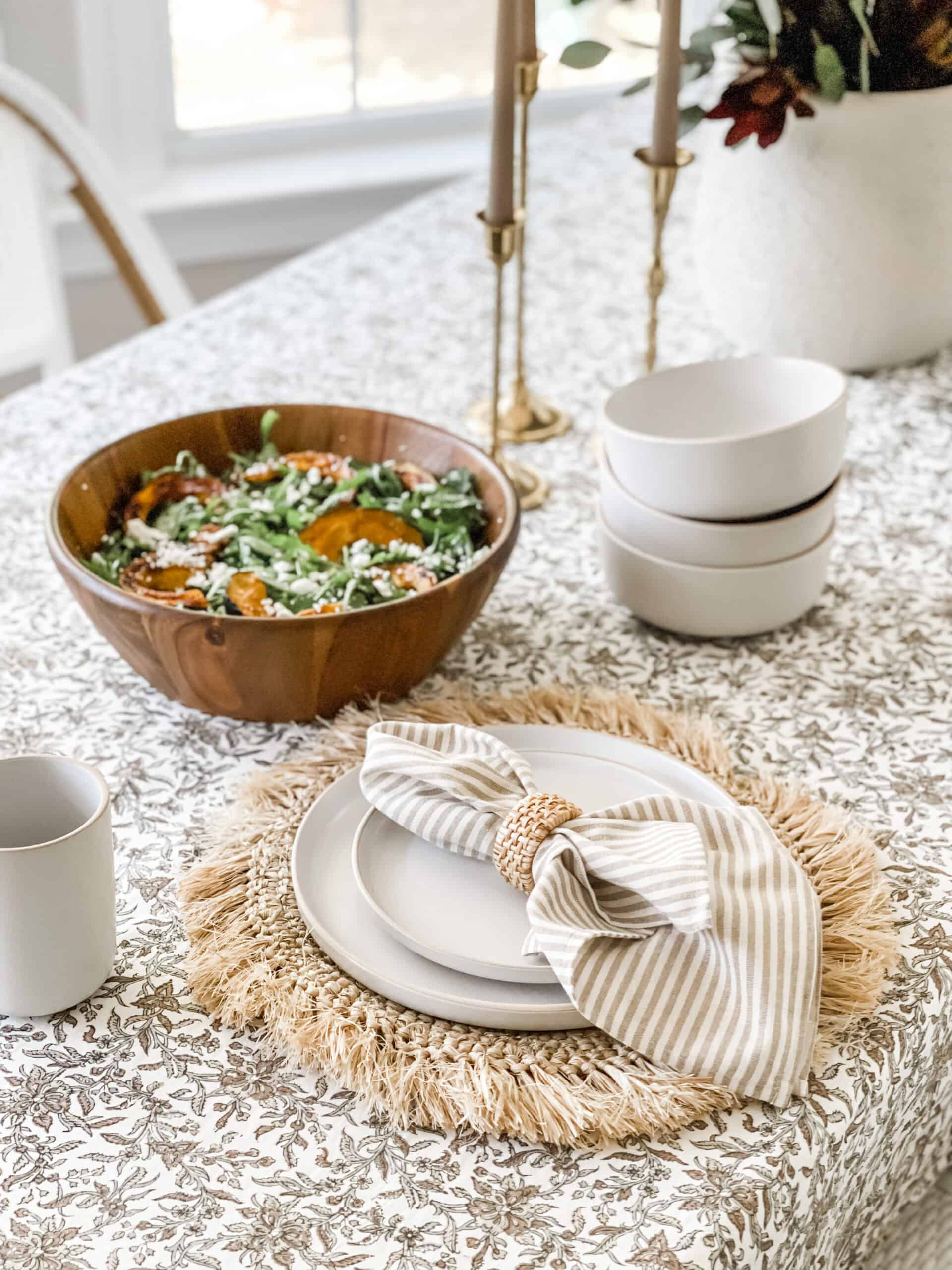 Traditional fall tablecloth with raffia placemats.