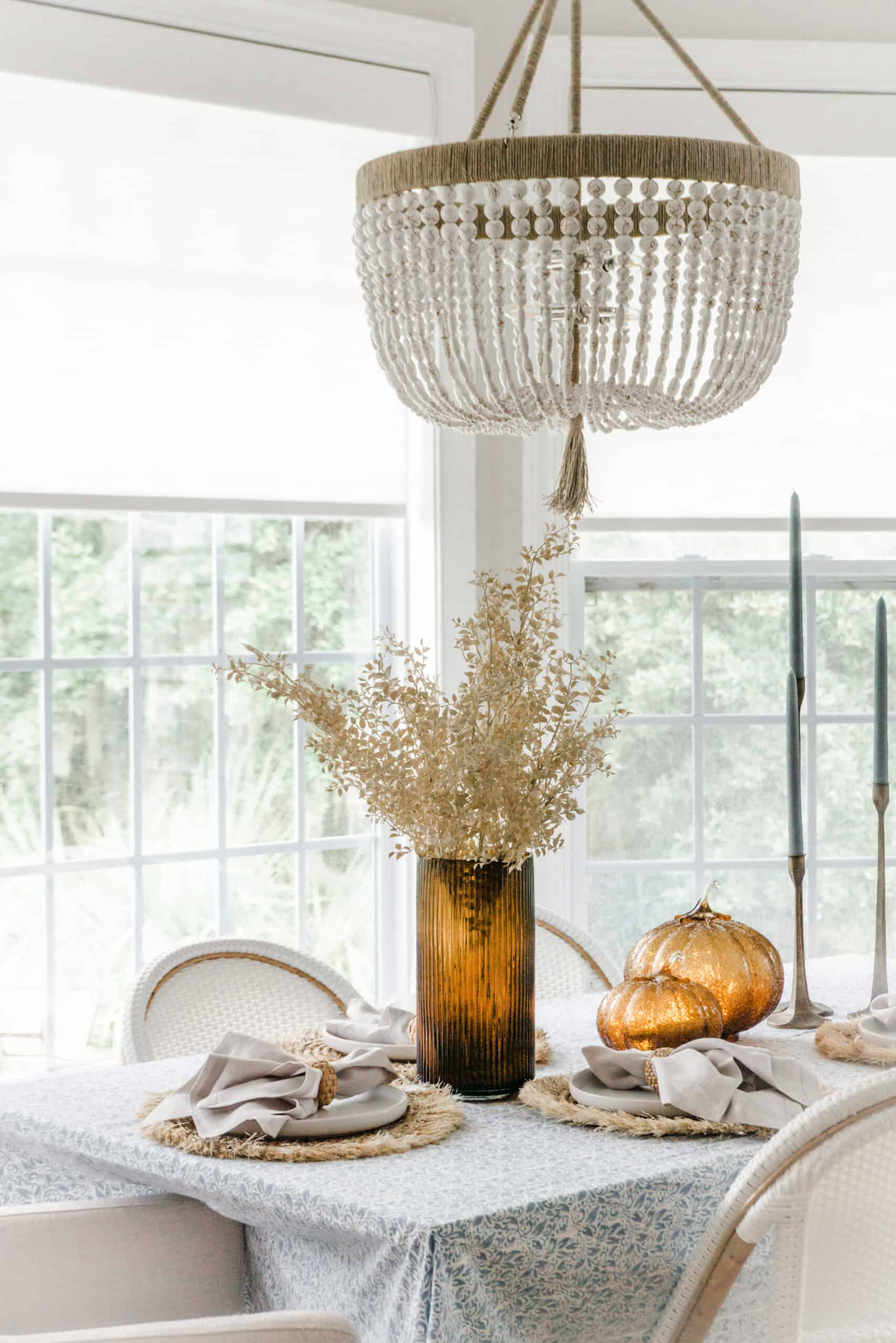 Fall tablescape with beaded chandelier and coastal blue tablecloth.