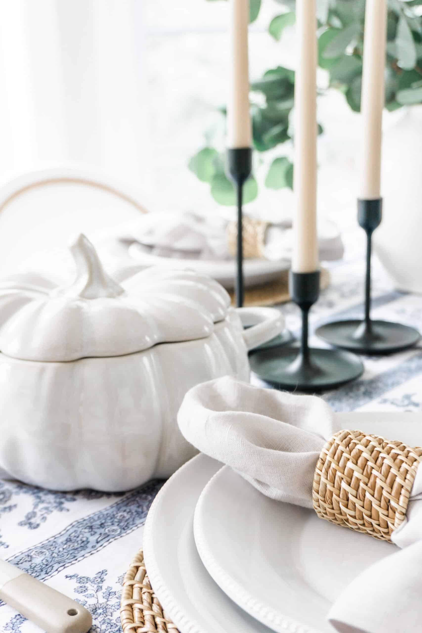Pumpkin serving dish on table setting.